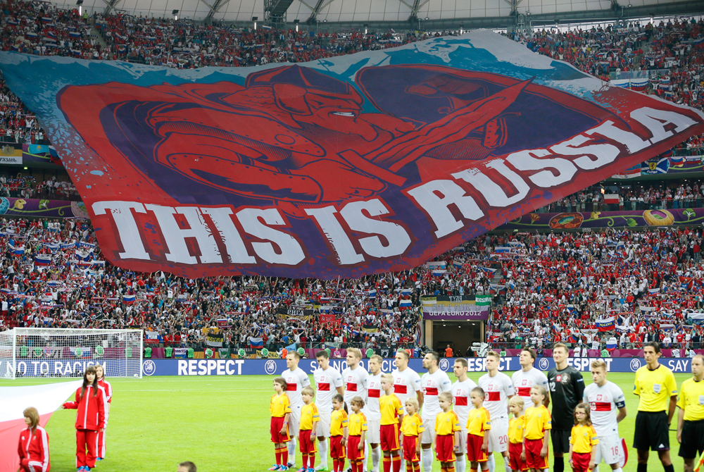 Russia fans hold up giant banner before Euro 2012 soccer match against Poland in Warsaw